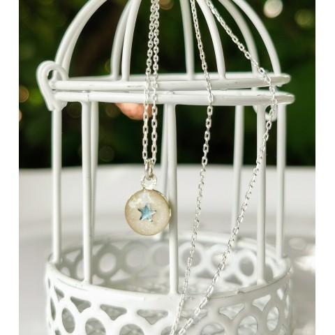 Синя звезда - нежен сребърен медальон с кърма
